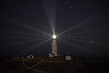 white lighthouse at night