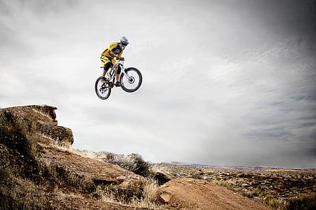man riding mountain bike wearing off-road helmet flying 3D wallpaper
