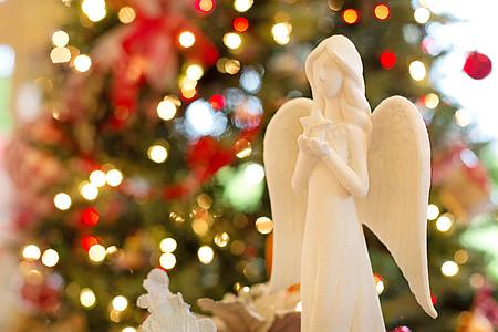selective focus photo of white angel figurine