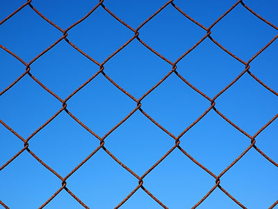 rusted brown metal chain link fence