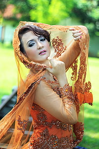 woman in orange and grey floral sequin dress