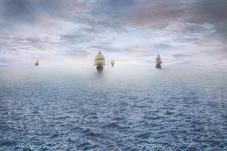 six galleon ships on body of sea during daytime