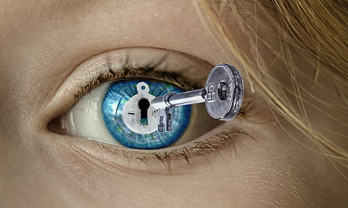 silver skeleton key and blue eyes graphic animation display wallpaper