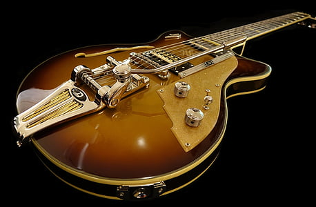 brown electric guitar