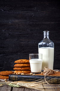 cookies near milk glass and bottle