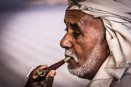 man with pipe and white bandana