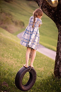 girl ride on vehicle tire swing