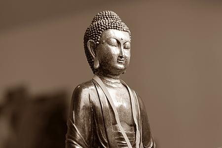 gray buddha figurine