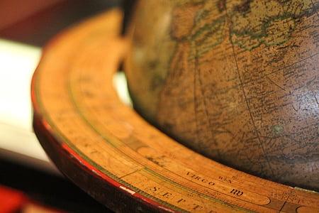 brown wooden desk globe