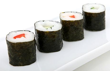 sushi on white ceramic platter