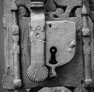 door lock grayscale photo