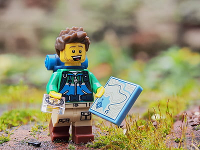 shallow focus photography of hiker LEGO plastic toy