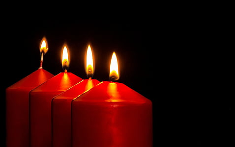 four red lighted pillar candles