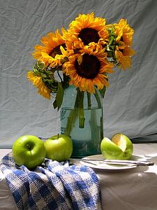 sun flowers on clear glass vase