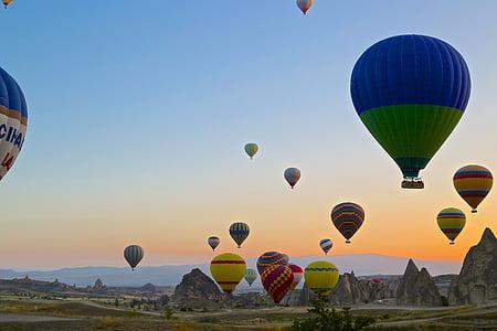 hot air balloons during sunset