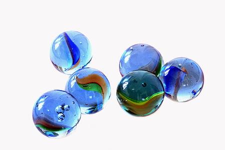 six blue marble toys on white background