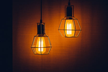 two orange ceiling pendant lamps turned on