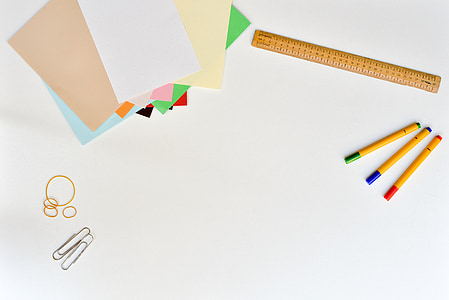 three yellow pen and yellow measuring ruler