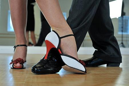 woman wearing white and black peep-toe heels