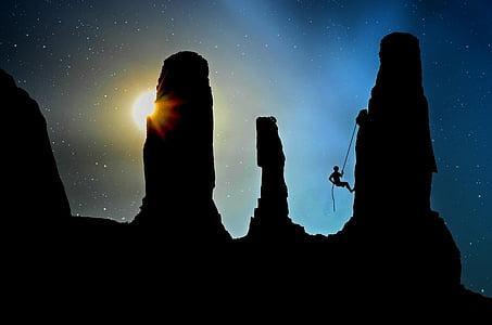 man climbing on the rock mountain