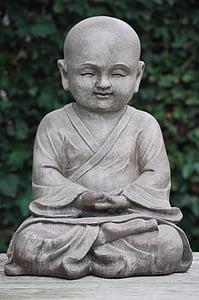 monk in lotus position statuette
