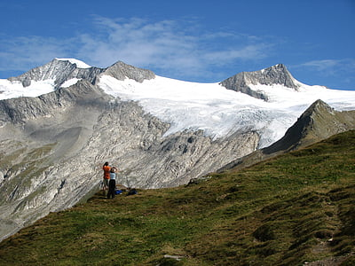 landscape photo of two person standing on mountain