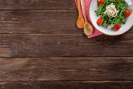 salad on white ceramic plate on brown wooden table