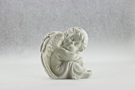 cherub white concrete statuette