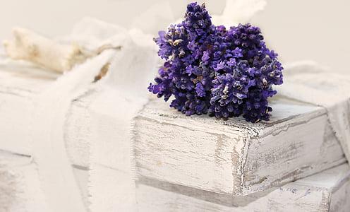 purple petaled flowers on white wooden board