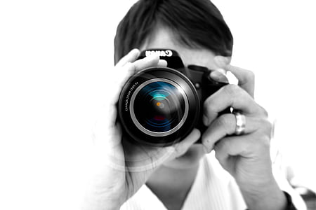 closeup photo of person holding camera