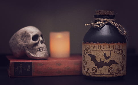 Bat Wing Potion bottle near bottle and skull