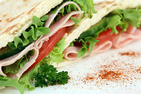 sandwich with lettuce, sliced tomatoes, and cold cuts