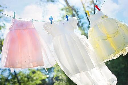 girl's three pink, white, and yellow sleeveless dress