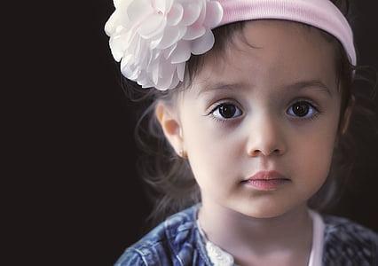 baby wears pink floral headdress