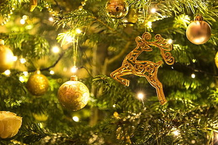 gold-colored Christmas baubles and string lights