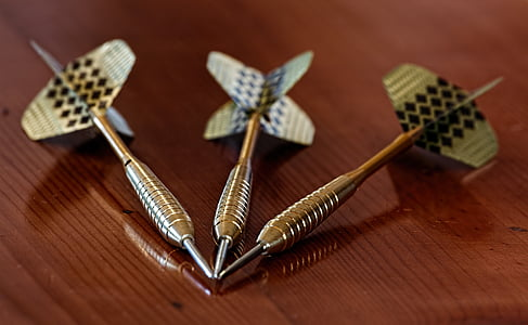 three silver-colored dart pins