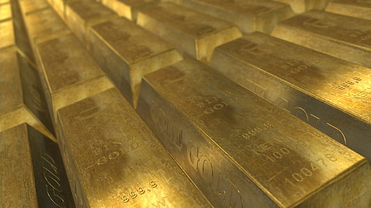 closeup photo pile of gold bars