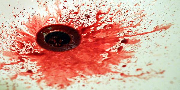 blood on white ceramic sink