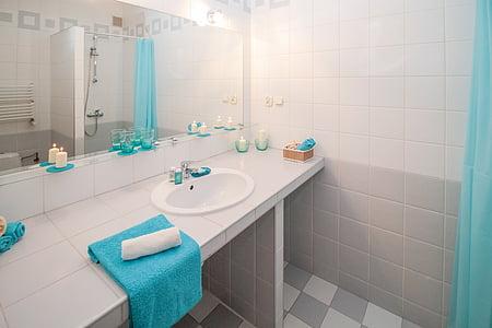 blue towel on white ceramic sink