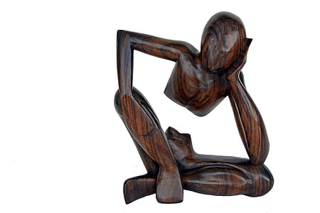 brown wooden human figure sculpture
