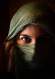 woman wears green headscarf