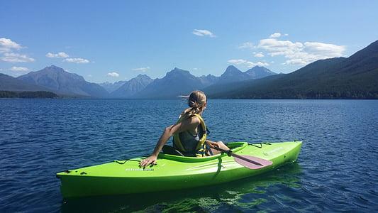 woman riding on kayak