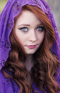 woman in purple headdress