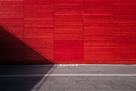 red concrete wall during daytime