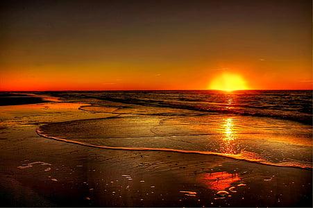 calm body of water during sundown