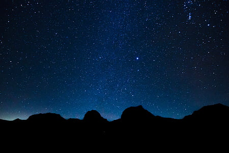 mountains during night time