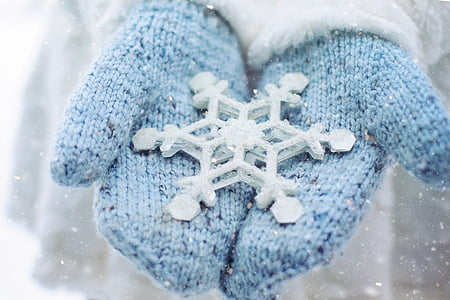 pair of blue knitted gloves