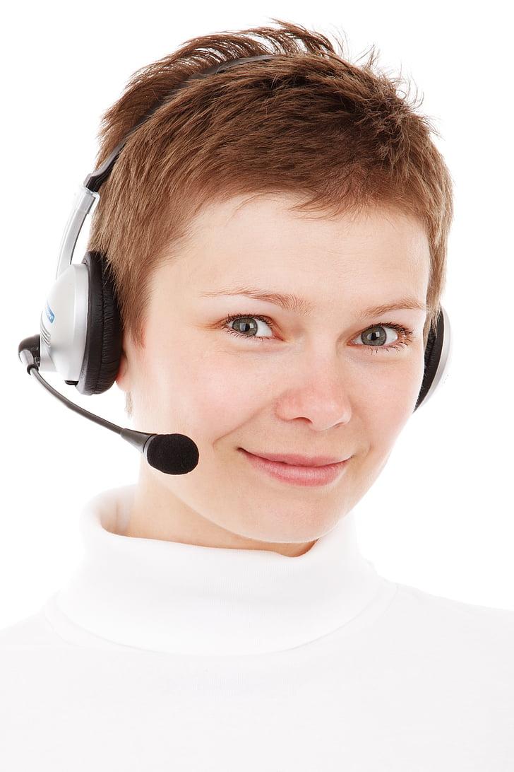 woman wearing white turtleneck shirt with gray headset