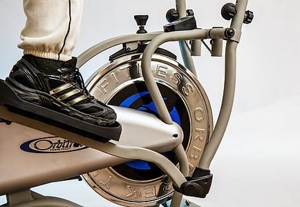 person on Orbit elliptical trainer