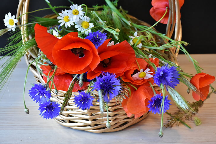 brown wicker basket with flowers